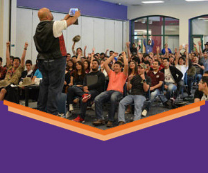 Presenter in front of a crowd